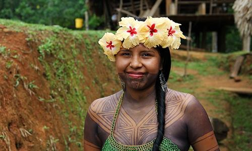 Emberá with traditional temporary paint on her body