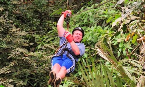 A Man Ziplining in the Anton Valley