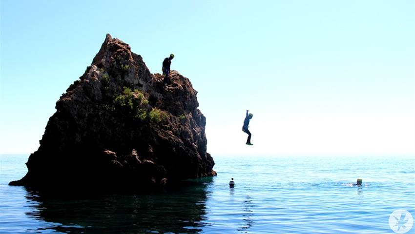 jumping into the water from the cliff - tiqy, Coasteering in Nerja – Malaga