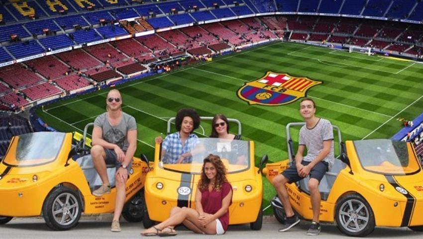 Camp Nou Special group of persons and yellow Go cars, Camp Nou Special Tour