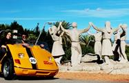 Barcelona Day Tour yellow go car in monument, Barcelona Day Tour