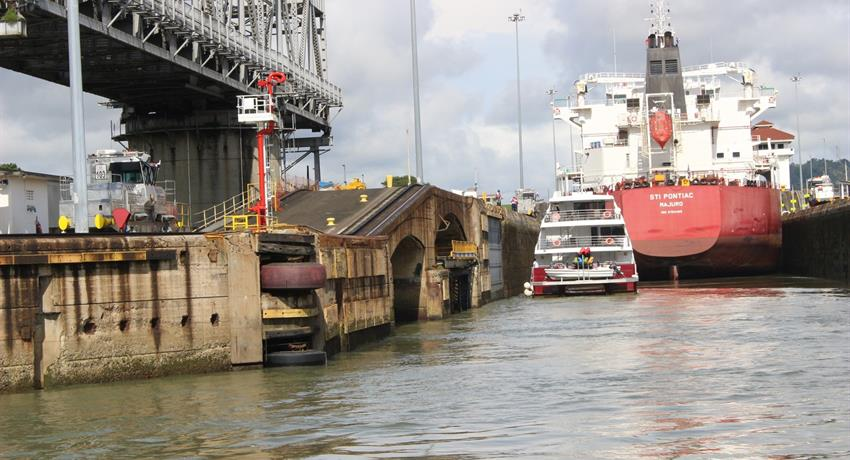 Ship crosshing the panama canal - tiqy, Partial Transit through the Panama Canal
