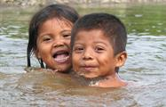 indigenous kids playing in the river - Tiqy, Bribri Indigenous Reserve