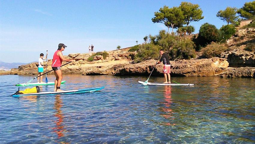 stand up paddle on the way to cala brava - tiqy, Stand Up Paddle Tour in Cala Brava Caves