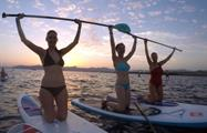 group of friends doing paddle - tiqy, Sunset Paddle Tour